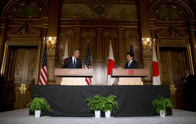 President Barack Obama, left, and Japanese Prime Minister Shinzo Abe participate in a joint news conference at the Akasaka State Guest House in Tokyo, Thursday, April 24, 2014. Obama is seeking to rea