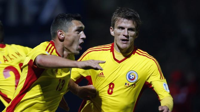 Romania's Keseru and Lazar celebrate a goal against Andorra during their 2014 World Cup qualifying soccer match at Estadi Comunal in Andorra