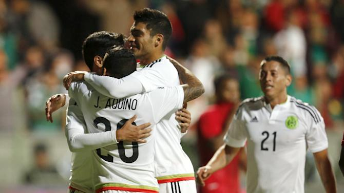 Players of Mexico celebrate their team's first goal after teammate Carlos Vela scored against Panama during a friendly soccer match