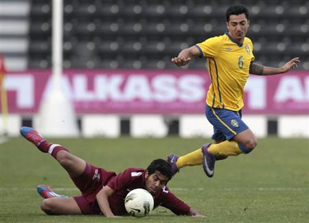 Sweden's Hamad fights for the ball with Qatar Olympic team's AlJabri during their international friendly match in Doha