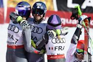 From left, gold medalists of France Alexis Pinturault, Mathieu Faivre and Tessa Worley celebrate in the finish area after the final of the team event at the 2017 FIS Alpine Skiing World Championships in St. Moritz, Switzerland, Tuesday, Feb. 14, 2017. (Gian Ehrenzeller/Keystone via AP)