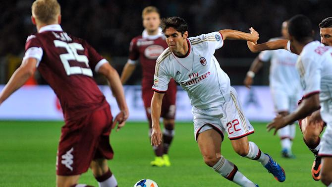 """In this Saturday, Sept. 14, 2013 file photo AC Milan Ricardo Kaka, of Brazil, center, controls the ball past Torino's Kamil Glik, of Poland, during a Serie A soccer match at the Olympic stadium, in Turin, Italy. Kaka has asked AC Milan to stop paying his salary until he recovers from an injury. In a video message on Monday, Sept. 16, 2013 Kaka says """"I don't want anything from Milan except for love and support until I am better. ... for this reason, I have decided to suspend my current pay for this period of time."""" Kaka returned to Milan in the offseason, four years after leaving for Real Madrid in what was a world record transfer at the time"""