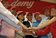 Newly appointed AirAsia CEO of Malaysian Operations Aireen Omar (third left) joins Group CEO Tony Fernandes (second left), and other top officials at a ceremony in Sepang, outside Kuala Lumpur on Monday. Fernandes on Monday said he was handing over his role as head of Malaysia operations to shift focus to oversee the budget carrier's regional expansion
