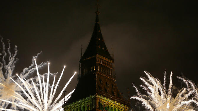 Fireworks explode over Elizabeth Tower housing the Big Ben clock to celebrate the New Year in London, Tuesday, Jan. 1, 2013. (AP Photo/Kirsty Wigglesworth)