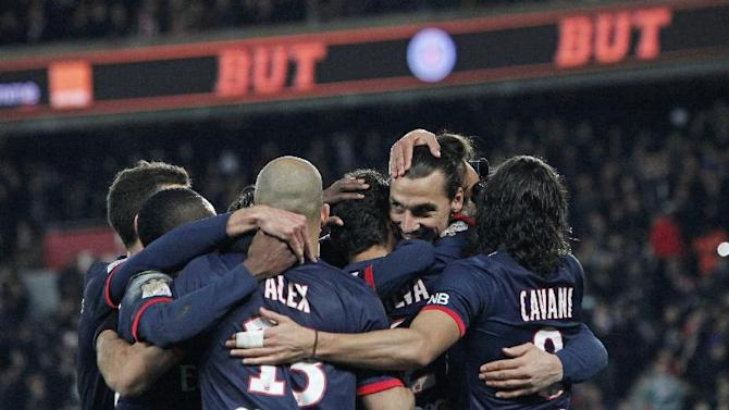 Paris Saint Germain's forward Zlatan Ibrahimovic from Sweden, second from right, celebrates with teammates after Paris Saint Germain's Thiago Silva scored, during their French League one soccer match against Sochaux, in Parc des Princes stadium, in Paris, Saturday, Dec. 7, 2013