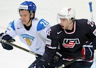 US player Craig Smith (R) and Finland's Jarkko Immonen during the International Ice Hockey World Championship quarter-final game on May 17. Finland won through to the last four with a last-gasp winner against the US on Thursday