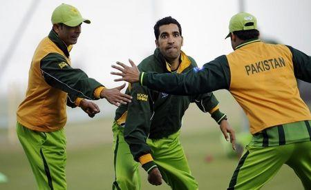 Pakistan's Umar Gul attempts to throw a flying disc during a training session before the second cricket test match against England at the Sheikh Zayed Stadium in Abu Dhabi