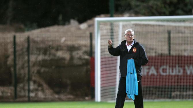 Marcello Lippi, coach of China's Guangzhou Evergrande, gestures during a training session in Agadir Stadium, Agadir