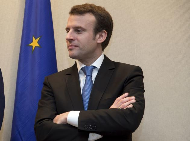 French Economy minister Emmanuel Macron attends a signing ceremony of economic partnerships between Quebec and France in Paris