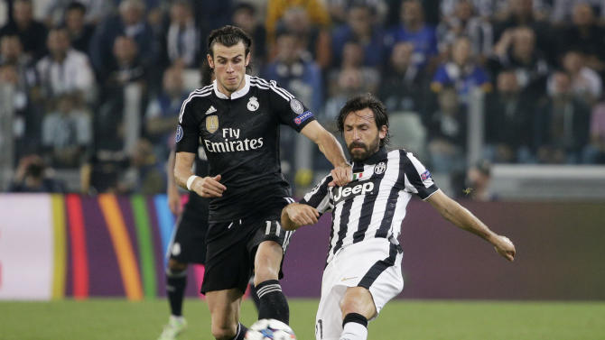 Football: Real Madrid's Gareth Bale in action with Juventus' Andrea Pirlo