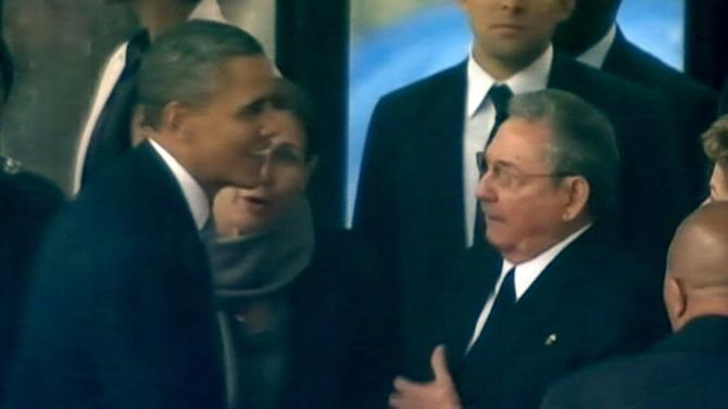 Obama, Cuban President Raul Castro Shake Hands at Nelson Mandela Memorial