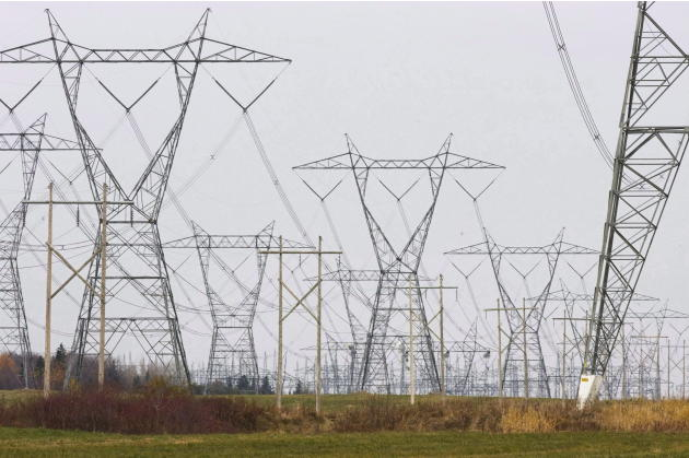 In this Oct. 29, 2009 photo, electric power lines cover the landscape in Levis, Quebec. Critics of proposals to import relatively clean hydropower from Quebec into the Northeastern United States worry