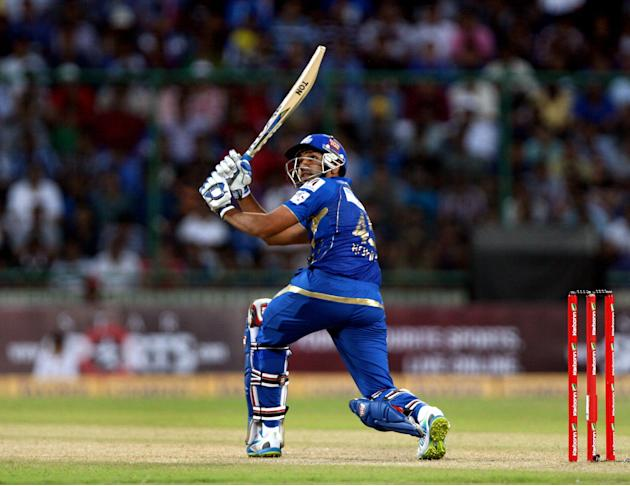 Rohit Sharma of Mumbai Indians plays a shot during the CLT20 match between Perth Scorchers and Mumbai Indians at Feroz Shah Kotla, Delhi on Oct. 2, 2013. (Photo: IANS)