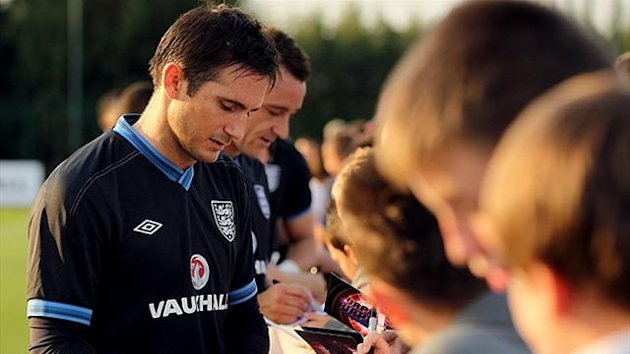 Frank Lampard signs autographs for young fans (PA Photos)