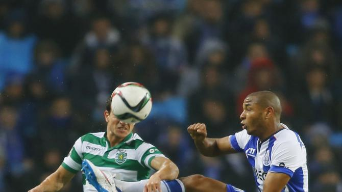 Porto's Brahimi fights for the ball with Sporting's Cedric during their Portuguese Premier League soccer match at Dragao stadium in Porto