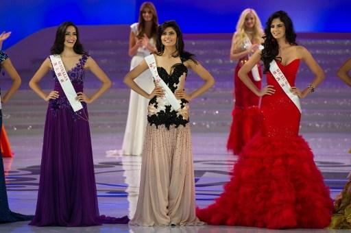 (From-L) Miss Australia Jessica Kahawaty, Miss India Vanya Mishra and Miss Mexico Mariana Reynoso pose during the Miss World 2012 final ceremony at Dongsheng Stadium in the inner Mongolian city of Ord