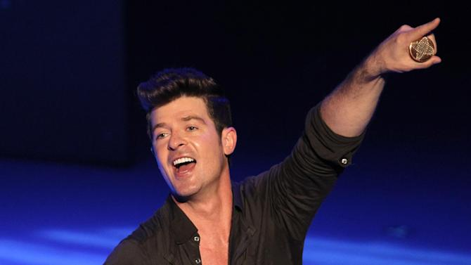 """FILE - In this Sept. 7, 2012 file photo, musician Robin Thicke performs during Macy's Passport presents Glamorama 2012 at The Orpheum Theatre in Los Angeles. NBC says it's lining up musical artists including Rod Stewart to perform on """"The Voice"""" in May. The network said Monday, April 29, 2013, that Stewart, CeeLo Green, Lady Antebellum, Robin Thicke, Pharrell Williams and T.I. will take the stage on upcoming episodes of the hit singing contest. (Photo by Matt Sayles/Invision/AP, File)"""
