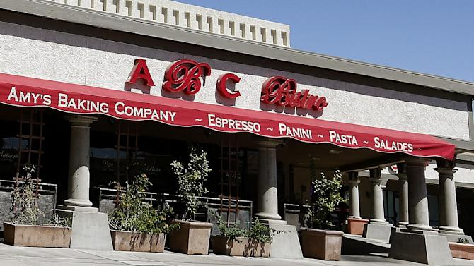 """This Monday, June 3, 2013 photo shows Amy's Baking Company in Scottsdale, Ariz. The restaurant temporarily closed after their """"Kitchen Nightmares"""" episode aired. The episode of """"Kitchen Nightmares"""" drew more than a million viewers on YouTube, and restaurateur Amy Bouzaglo's vitriolic rants became popular fodder on Twitter and Facebook. Bouzaglo announced she is shopping around her own reality TV show. (AP Photo/Ross D. Franklin)"""