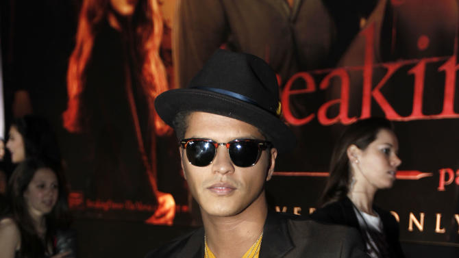 "Bruno Mars arrives at the world premiere of ""The Twilight Saga: Breaking Dawn - Part 1"" on Monday, Nov. 14, 2011, in Los Angeles. (AP Photo/Matt Sayles)"