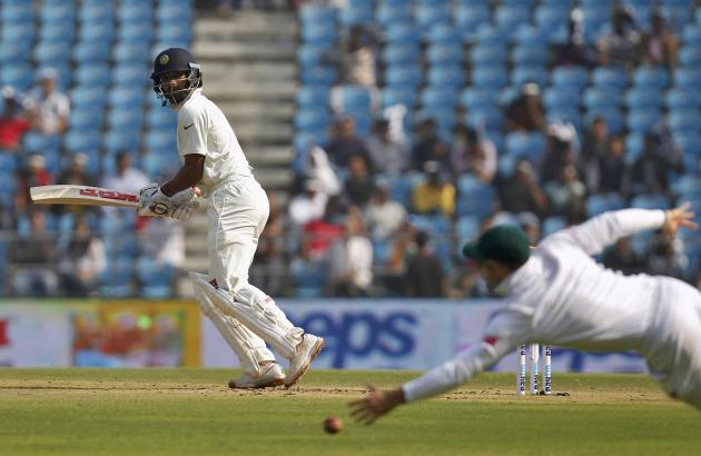 India's Dhawan watches the ball after playing a shot on the first day of their third test cricket match against South Africa in Nagpur