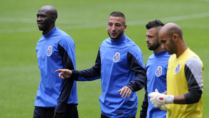FC Porto's Eliaquim Mangala from France, left, Nabil Ghilas from Algeria, second left, Steven Defour from Belgium and goalkeeper Sinan Bolat from Turkey, right, arrive for a training session at the Dragao stadium, in Porto, Portugal, Monday, Sept. 30, 2013. Porto will play Atletico Madrid in a Champions League group G soccer match on Tuesday, Oct. 1