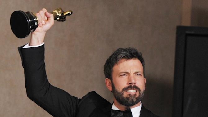 """Ben Affleck poses with his award for best picture for """"Argo"""" during at the Oscars at the Dolby Theatre on Sunday Feb. 24, 2013, in Los Angeles. (Photo by John Shearer/Invision/AP)"""