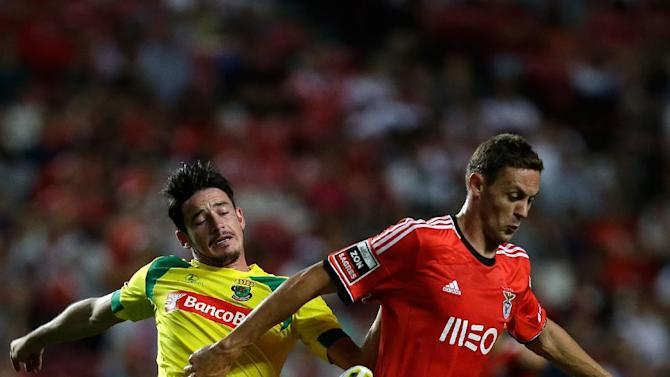 Benfica's Nemanja Matic, from Serbia, right, controls the ball past Pacos de Ferreira's Romeu Rocha during their Portuguese league soccer match Saturday, Sept. 14, 2013, at Benfica's Luz stadium in Lisbon