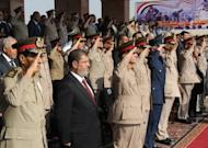 Picture made available by the Egyptian presidency on June 30, shows President Mohamed Morsi (2nd L) watching a parade next to military council chief, Field Marshal Hussein Tantawi (L) and other senior officers in Cairo. Morsi began his first full day in office on Sunday, but with his powers sharply circumscribed by the military that has ruled since Hosni Mubarak was ousted from power last year