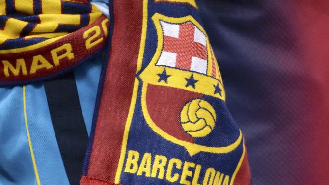 Scarves are seen before the Champions League round of 16 first leg soccer match between Manchester City and Barcelona at the Etihad Stadium in Manchester