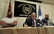 """Political leader of the far-right party 'Golden Dawn', Nikolaos Michaloliakos speaks during a press conference at an hotel in Athens. Greek neo-Nazi party Golden Dawn warned rivals and reformers Sunday that """"the time for fear has come"""" after exit polls showed them securing their entry in parliament for the first time in nearly 40 years"""