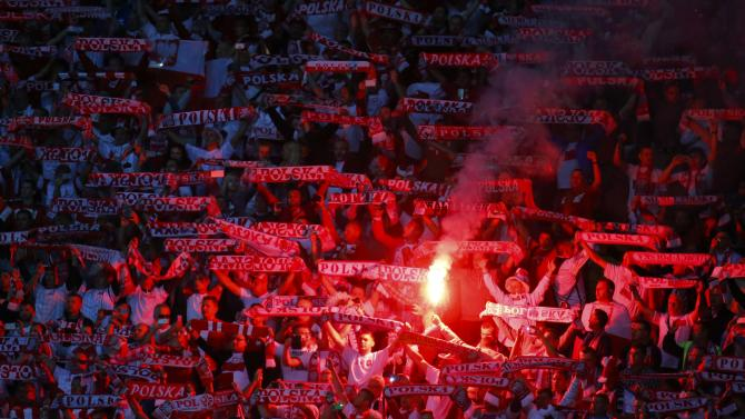 Polish soccer fans light flares ahead of their Euro 2016 qualification match against Germany in Frankfurt