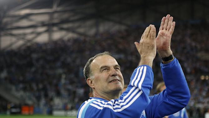 Olympique Marseille's coach Bielsa gestures at the end of match against Bastia during their French Ligue 1 soccer match at the Velodrome Stadium in Marseille