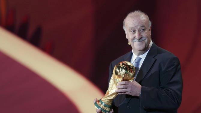 Bosque holds the World Cup trophy at the draw for the 2014 World Cup in Sao Joao da Mata