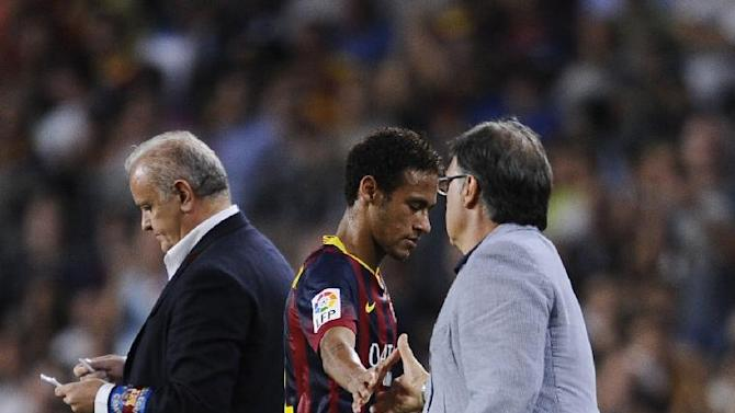 FC Barcelona's Neymar, from Brazil, second right, gestures to his coach Gerardo Martinez, right, against Real Sociedad during a Spanish La Liga soccer match at the Camp Nou stadium in Barcelona, Spain, Tuesday, Sept. 24, 2013