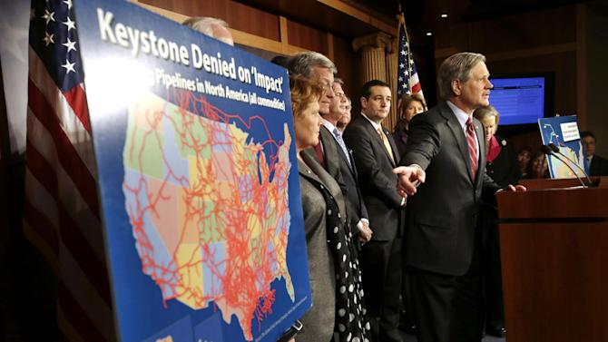 FILE - In this Jan. 23, 2013, file photo, Sen. John Hoeven, R-N.D, points at a illustration of existing pipeline, while speaking at a news conference about the Keystone XL oil pipeline on Capitol Hill in Washington. The State Department on Friday, March 1, 2013, raised no major objections to the Keystone XL oil pipeline and said other options to get the oil from Canada to U.S. Gulf Coast refineries are worse for climate change. But the latest environmental review stops short of recommending whether the project should be approved.  (AP Photo/Jacquelyn Martin, File)