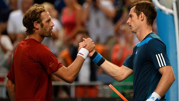 Andy Murray (R) of Britain shakes hands with Stephane Robert of France (Getty Images)