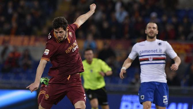 AS Roma's Mattia Destro, left, shoots to score during a Serie A soccer match between AS Roma and Sampdoria, at Rome's Olympic stadium, Sunday, Feb. 16, 2014