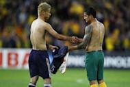 Japan's Keisuke Honda (L) exchanges jersey's with Australian player Tim Cahill at the conclusion of the 2014 World Cup qualifying football match between Australia and Japan at Suncorp Stadium in Brisbane. Ten-man Australia held free-flowing Japan to a 1-1 draw in World Cup qualifying Tuesday, as South Korea marched towards Brazil 2014 with a 3-0 hammering of Lebanon