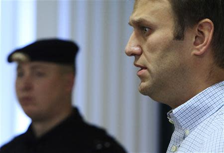 Russian opposition leader Alexei Navalny (R) attends a court session in Kirov October 16, 2013. REUTERS/Maxim Shemetov