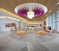 In this undated photo provided by Perkins+Will, a fantastic flower blooms overhead in the dining area at Nemours children's hospital in Orlando, with a design theme centered on creating a hospital in a garden. (Jonathan Hillyer Photography/Perkins+Will via AP)