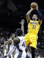 Indiana Pacers' Danny Granger (33) goes up for a shot against New Jersey Nets' Gerald Wallace in the first quarter of an NBA basketball game on Wednesday, March 28, 2012, in Newark, N.J. (AP Photo/Julio Cortez)