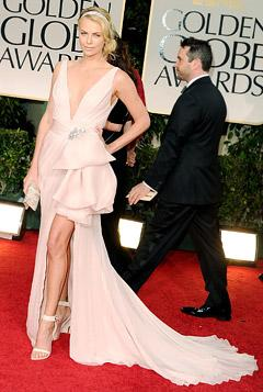 Golden Globes 2012: Charlize Theron Stuns in Plunging Dress, Diamond Headband