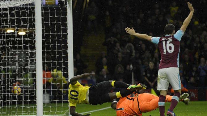 Watford's Isaac Success shoots wide under pressure from West Ham United's Darren Randolph
