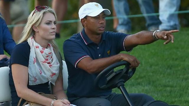 Golf - With high fives and a squirrel prank Tiger enjoys opening win