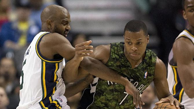 Toronto Raptors guard Kyle Lowry (7) is defended by Utah Jazz guard John Lucas III during the first half of an NBA basketball game in Toronto on Saturday, Nov. 9, 2013