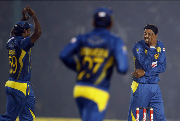 Sri Lanka's Sachithra Senanayake, right, smiles as he celebrates taking the wicket of Pakistan's Sohaib Maqsood during the opening match of the Asia Cup one-day international cricket tournament betwee
