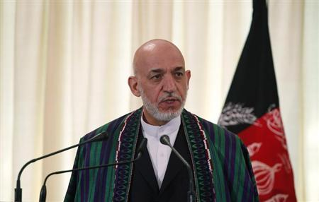 Afghan President Hamid Karzai speaks during a joint news conference with Pakistan's Prime Minister Nawaz Sharif (not pictured) at the prime minister's residence in Islamabad August 26, 2013. REUTERS/Mian Khursheed