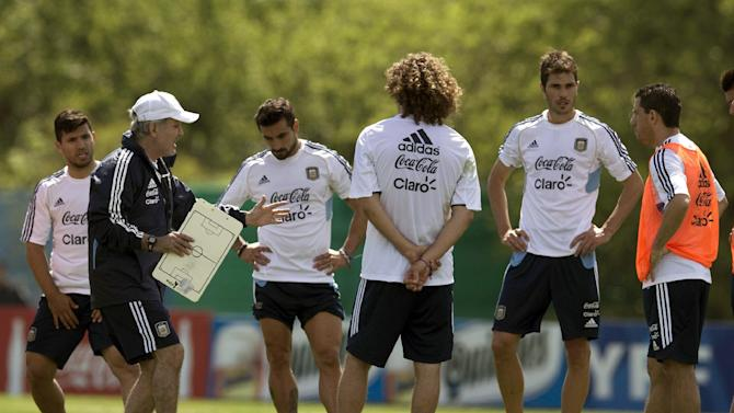 Argentina's coach Alejandro Sabella talks to his players during a training session ahead a Brazil 2014 World Cup qualifying soccer match against Peru in Buenos Aires, Argentina, Tuesday, Oct. 8, 2013