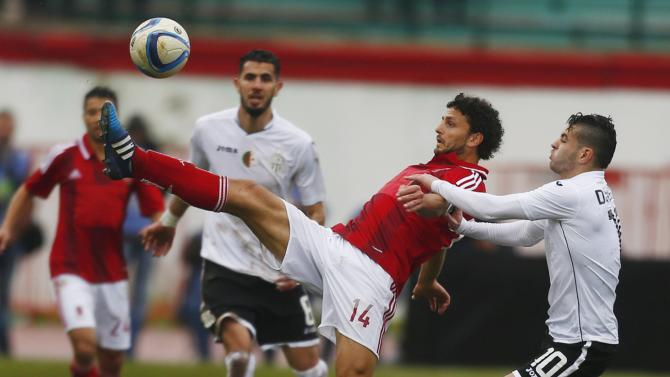 Ghaly of Al-Ahly fights for the ball with Djahnit of Entente Setif during their African Super Cup soccer match in Blida