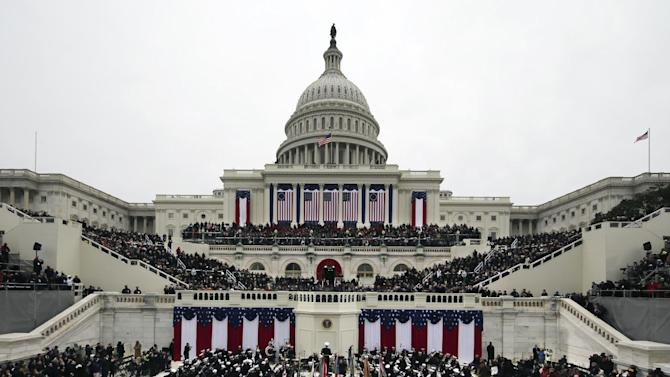 President Barack Obama waves after his Inaugural speech at the ceremonial swearing-in on the West Front of the U.S. Capitol during the 57th Presidential Inauguration in Washington, Monday, Jan. 21, 2013. (AP Photo/Scott Andrews, Pool)
